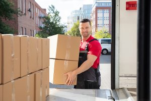 removalist while holding a big box