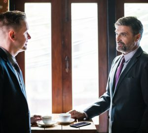 man consulting about divorce dispute resolution to a lawyer